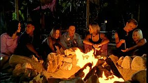 Natural (S Club 7 song) - S Club 7 sitting around the campfire at the end of the music video. (Left - Right) Barrett, McIntosh, Stevens, Cattermole, Spearritt, Lee and O'Meara.