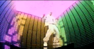 Rock Your Body - Timberlake dancing inside a cube surrounded by an array of colored lights.