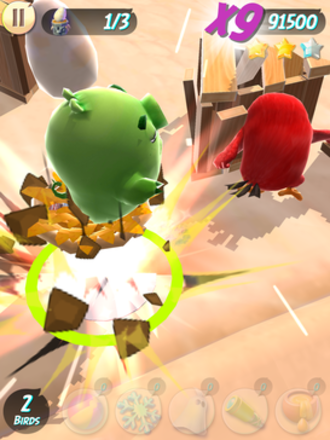 Angry Birds Action! - Screenshot of gameplay.  The camera is normally positioned at a top-down perspective, but occasionally zooms up close as the game goes into slow motion whenever the player is close to delivering a final blow.