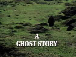 "The image is the title screen of the adaptation of ""The Signalman"". A lone traveller, wearing black Victorian travelling garments and silhouetted so that he cannot be identified, treads across green fields pockmarked by molehills. He is walking towards the camera. A slightly muggy, cloudy atmosphere pervades the image. The strand title ""A Ghost Story"" is superimposed over this in bold, white capital letters."