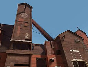 Team Fortress 2 - The exterior of a RED base, showing warm colors, angular shapes and wooden construction materials