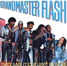 An album cover with seven smiling and laughing men standing in a row and dressed in various styles of denim clothing.