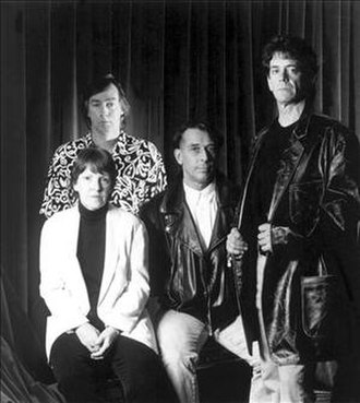 Lou Reed - 1993 Velvet Underground reunion promotional photo. From left to right: Morrison (at back), Tucker, Cale and Reed