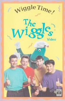 Cover showing four of The Wiggles doing their thumbs up with Dorothy the Dinosaur at the back holding her bag.