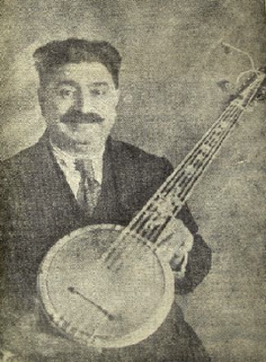 Cümbüş - Zeynel Abidin Cümbüş holding one of the instruments he invented, from a newspaper clipping