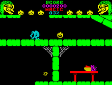 Horizontal rectangular video game screenshot that is a digital representation of a castle interior. A yellow pumpkin bounces on the second floor of a castle room. To the left of the pumpkin is a blue monster, while a red table with a bowl of fruit is below on the first floor.