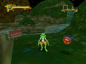 Frogger: The Great Quest - A screen capture of Frogger's first appearance in the PC version of the game, with a coin to the right, one of many to collect.