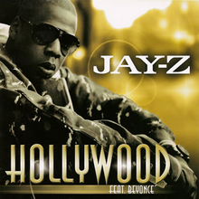 "An African-American man is sitting. He wears a dark glasses and a dark jacket with many white stains, and behind him, the background is yellow. Near to him, the word ""Jay-Z"" is written in white capital letters, ""Hollywood"" in golden capital letters, and ""Feat. Beyoncé"" in white over a golden strip."