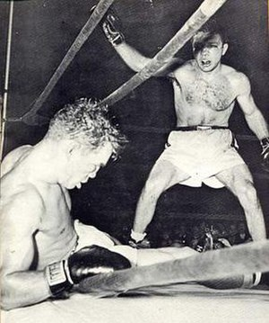 Laurent Dauthuille - Laurent Dauthuille (left) is knocked down by Jake LaMotta with 13 seconds left in a September 13, 1950 middleweight title fight.