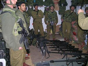Soldiers of the battalions Advanced Recon Company's (Palchod) Sniper Platoon (Machleket Tzalafim) prepare for a night-time operation into the West Bank Palestinian city of Tubas.