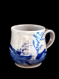 Mug with blue underglaze decoration on porcelain.