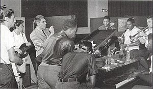 Otis Blue/Otis Redding Sings Soul - The Stax crew during the recording of Otis Blue, from left to right: Steve Cropper, Duck Dunn, engineer Tom Dowd, David Porter, Julius Green of the Mad Lads (seated with his back to the camera), Andrew Love, Floyd Newman, Wayne Jackson, Isaac Hayes