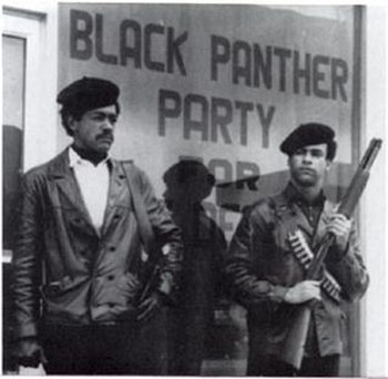 Black Panther Party members standing in the st...