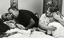 David Kirby on his deathbed, surrounded by his family.