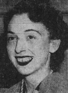 A young white woman smiling, from a 1940 newspaper photograph