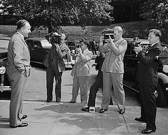 Embassy of Germany, Washington, D.C. - Ambassador Hans-Heinrich Dieckhoff is photographed by journalists leaving a meeting at the U.S. State Department in 1938.