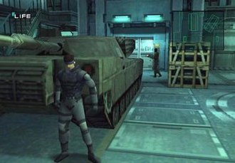 Metal Gear Solid - Solid Snake hiding from a guard, behind a M1 Abrams main battle tank. When Snake leans on a corner, the camera shifts to his front for dramatic effect and to enable sight down corridors