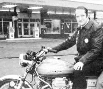 Mick Walker (motorcycling) - Walker in 1976 on a Moto Guzzi 850T3, in front of his then-newly acquired larger retail motorcycle premises at Norwich Road, Wisbech