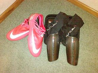 Nike Mercurial Vapor - A pair of Nike Mercurial Vapor IV Berry's (left) and Nike Mercurial Blade Carbon Fiber Shinguards (right).