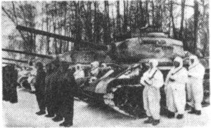 "Armenian Soviet Socialist Republic - Tankers and mechanized infantry from the 119th ""Sasuntsi-Davit"" Tank Regiment, a unit composed primarily of Soviet Armenians, stand next to their T-34/85 tanks. The name of the regiment can be seen inscribed in the Armenian script on the turrets of the tanks."