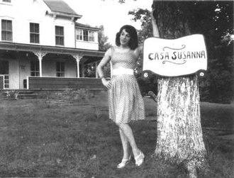 Casa Susanna - Susanna Valenti posing by her sign.