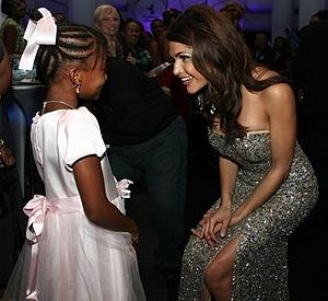 Gabrielle Walcott - Walcott speaking with a child at a gala function.
