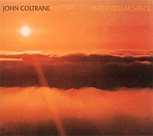 "An orange photo of the sun above the clouds with ""JOHN COLTRANE"" written in brown and ""INTERSTELLAR SPACE"" written in orange at the top."