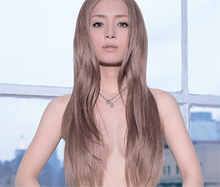 Ayumi Hamasaki shown topless from the upper waist up, looking into the camera, with flowing brown hair covering her chest.