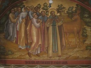 Miracle of the Moose - Depiction of the Miracle of the Moose in Pechersky Ascension Monastery. Note the clipped left ear of the animal: presumably, the fresco depicts the moment when the moose that had been marked by Macarius in this way returned to the Saint and his party