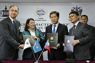 """Mongolian Stock Exchange - """"Master Service Agreement"""" signed on 7 April 2011 with Sükhbaataryn Batbold (third from left)"""