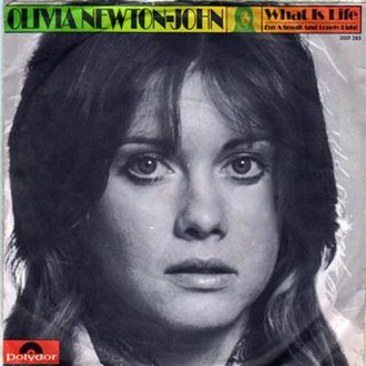 What Is Life - Image: Picture sleeve for Olivia Newton John single What Is Life