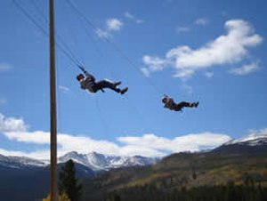 Colorado State University Mountain Campus - Students swing from the Giant Swing at the Challenge Ropes Course.