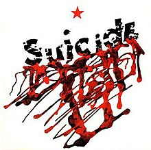 A white square shape featuring the a red star at the top center. Below the word Suicide is written diagonally across with blood seeping from it.