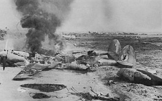 Daniel Z. Romualdez Airport - US P-38 in flames after a Japanese air raid on Tacloban