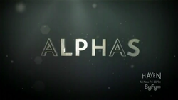 ALPHAS written in white against a grey-green background, the letters A are written as an outline