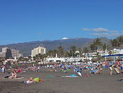 Playa de las Américas in December, hence the snowed mountains in the background