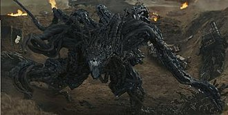 Edge of Tomorrow - An Alpha during the beach battle. The design for the extraterrestrial race aimed to be as otherworldly as possible, with a body consisting mostly of tentacles built out of obsidian-like shards.