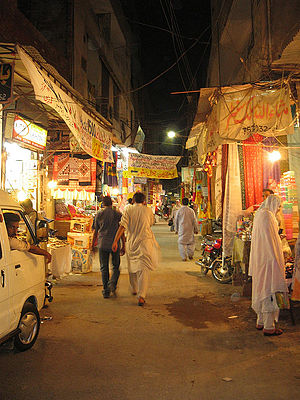 History of Lahore - Present view of the Ichhra Bazaar (Market) at night. The market, because of being designed in very old style is very narrow for vehicles to cross and shoppers to walk.
