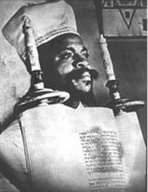 Black Hebrew Israelites - The founder of the Commandment Keepers, Wentworth Arthur Matthew holding a Sefer Torah.