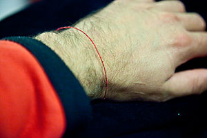 Religious clothing - Red string in Kabbalah.
