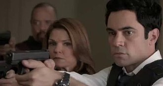 Acceptable Loss (Law & Order: Special Victims Unit) - Detectives Tutuola (Ice-T) and Amaro (Danny Pino) with Lt. Eames (Kathryn Erbe), their weapons trained on their suspects.