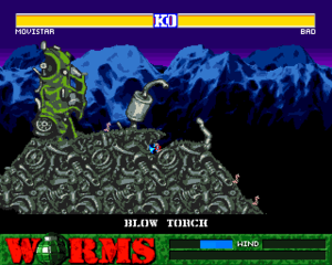 Worms (1995 video game) - From the Amiga version: A scrapyard themed level, with the player using the blowtorch tool.