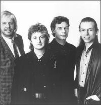Rick Wakeman - Wakeman (left) with Jon Anderson, Bill Bruford and Steve Howe in 1989.