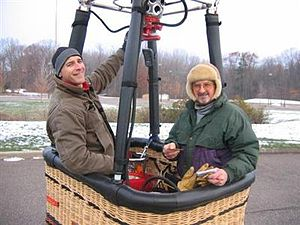 Hot air ballooning - Hot air balloon pilot and passenger in basket