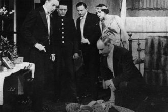 The Blue Mountains Mystery - Hotel guests including Billy Williams (left) and Majorie Osborne examine the supposedly dead Henry Tracey (John Faulkner).