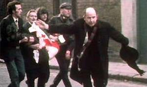 Bloody Sunday (1972) - Father Edward Daly waving a blood-stained white handkerchief while trying to escort the mortally wounded Jackie Duddy to safety