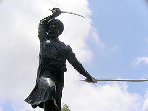 Mardani khel - Statue of Murar Baji wielding a pair of talwar
