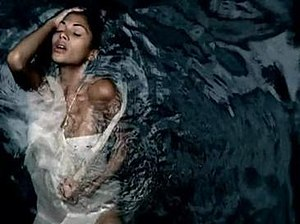 Whatever U Like - Scherzinger lying in a body of water as seen throughout the music video.