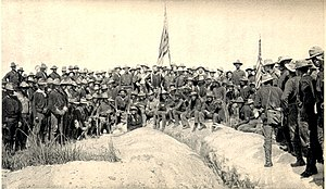 "3rd Cavalry Regiment (United States) - Original title: ""Colonel Roosevelt and his Rough Riders at the top of the hill which they captured, Battle of San Juan Hill."" Left to right is 3rd US Cavalry, 1st Volunteer Cavalry (Col. Theodore Roosevelt center) and 10th US Cavalry."
