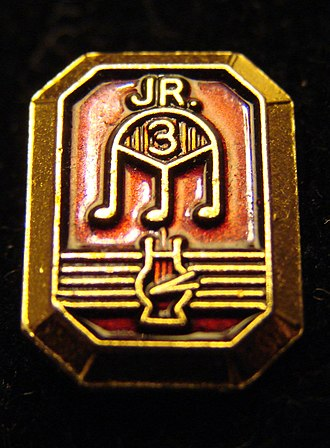 Tri-M - A membership pin awarded to junior inductees of the Tri-M Music honor society.